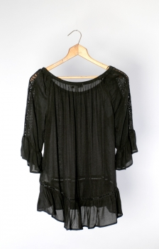 SOLID RUFFLE HEM BLOUSE WITH CROCHET LACE SHOULDER DETAIL