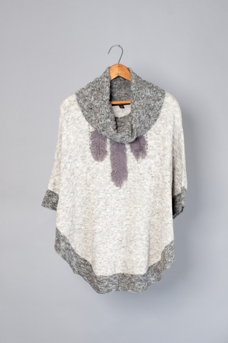 TURTLE NECK PONCHO WITH FEATHER POINTELLE DETAIL